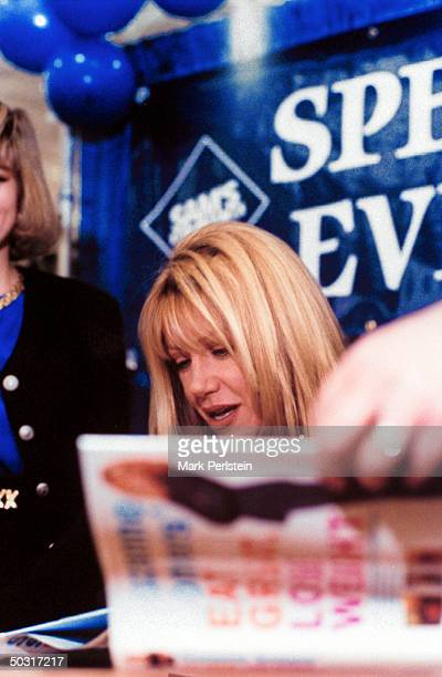 Actress Suzanne Somers autographing copies of her diet book EAT GREAT LOSE WEIGHT outside of a Sam's Club in Texas