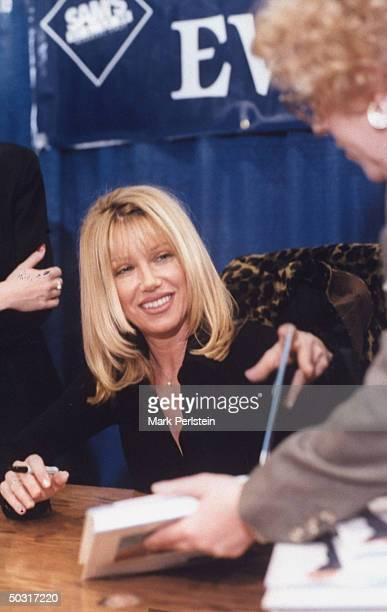 Actress Suzanne Somers autographing copies of her new book EAT GREAT LOSE WEIGHT outside of a Sam's Club in Texas