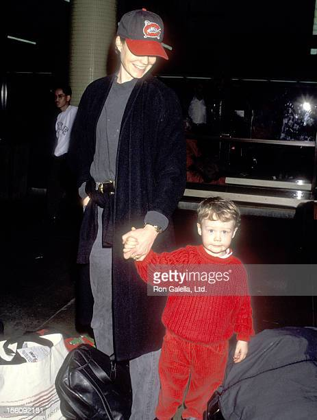 Actress Suzy Amis and son Jasper Robards on March 24 1993 arriving at the Los Angeles International Airport in Los Angeles California
