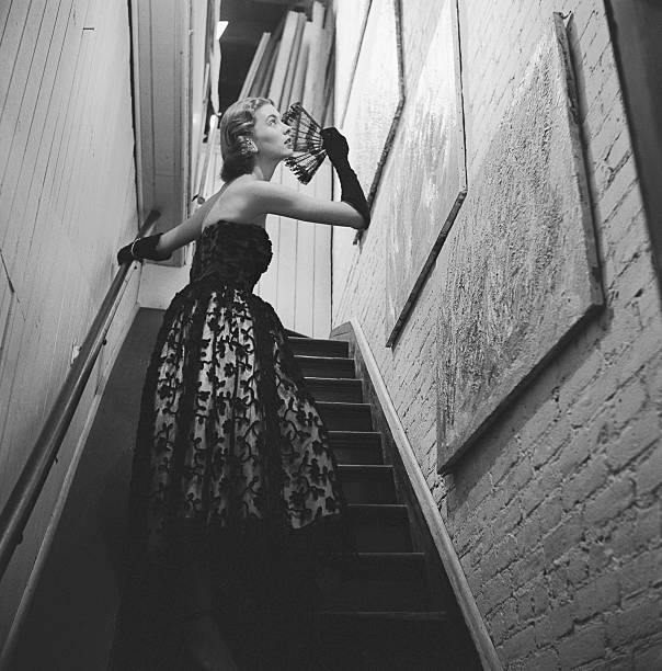 Actress in Evening Gown on Stairway Pictures | Getty Images
