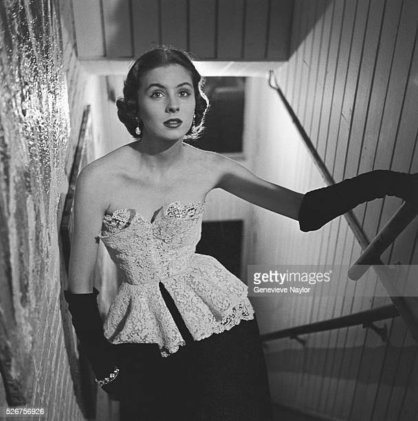 Actress Suzy Parker models a white cotton on black velvet evening gown by Anna Miller