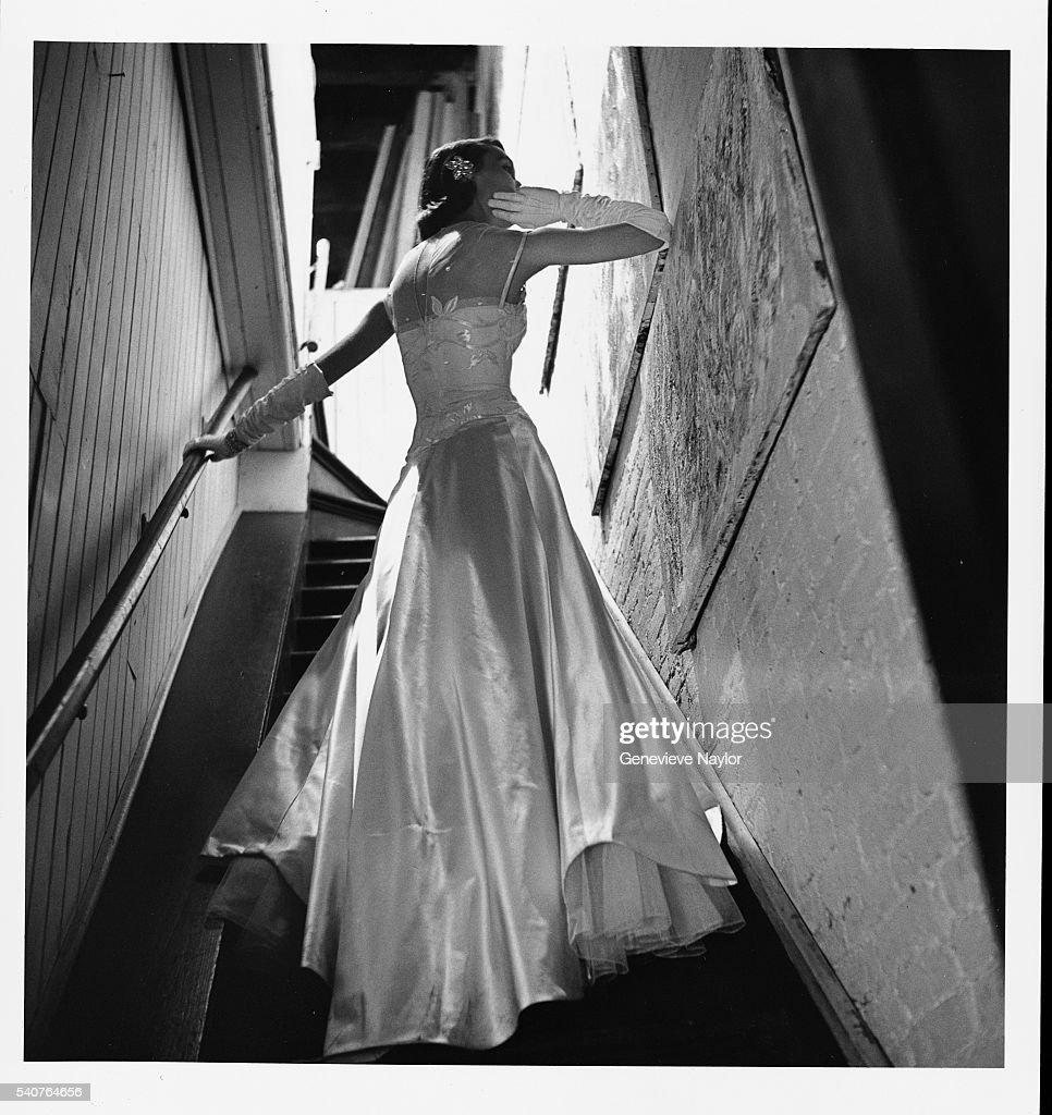 Actress Modeling Evening Wear on Stairway Pictures | Getty Images