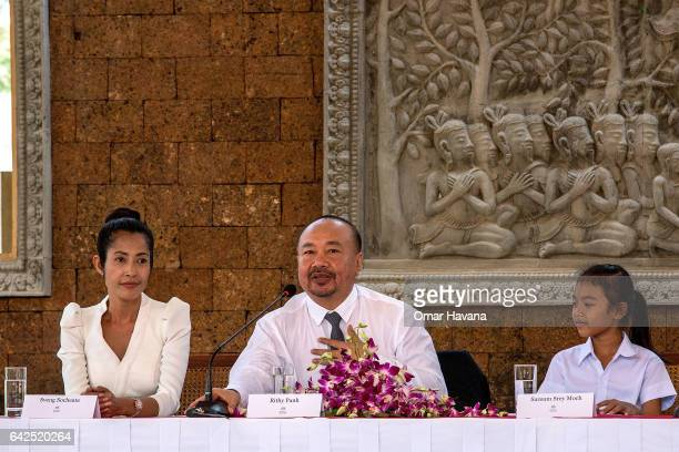 Actress Sveng Socheata and actress Sareum Srey Moch listen to producer Rithy Panh speak during a press conference ahead of the premiere of their new...