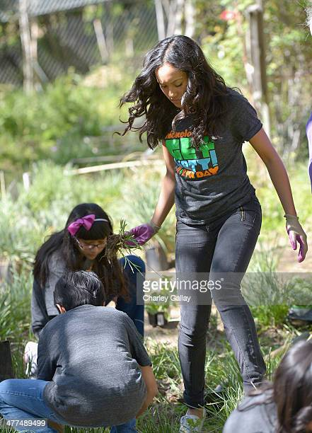 Actress Sydney Park and volunteers from Buchanan Street Elementary School attend Nickelodeon Get Dirty Earth Day at Los Angeles Zoo on March 9 2014...