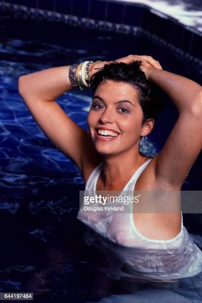 Actress Sydney Walsh Wearing Wet White Tank Top