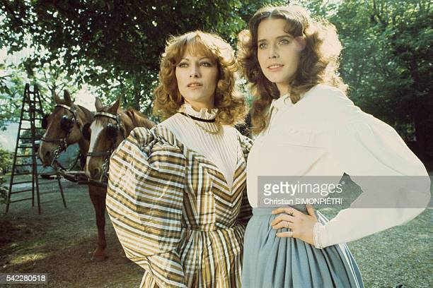 Actress Sylvia Kristel and Nathalie Delon on the set of Une Femme Fidele directed by Roger Vadim | Location Pouilly France