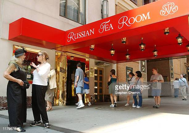 Actress Sylvia Miles and Harriett Lehrer chat as people look into the Russian Tea Room restaurant July 29, 2002 in New York City. The famous New York...