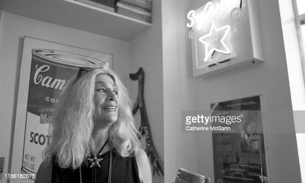 Actress Sylvia Miles poses for a portrait with her art collection, including works by Andy Warhol in her Central Park South apartment on September...