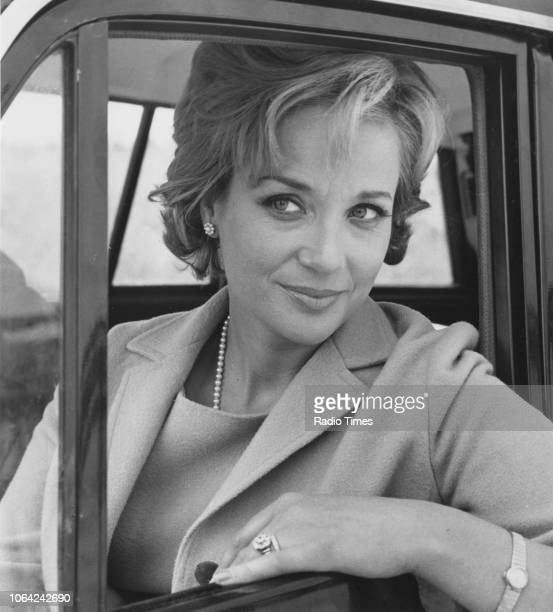 Actress Sylvia Syms pictured leaning from the window of a car in a scene from episode 1, series 1 of the television series 'Bat Out of Hell', 1966.