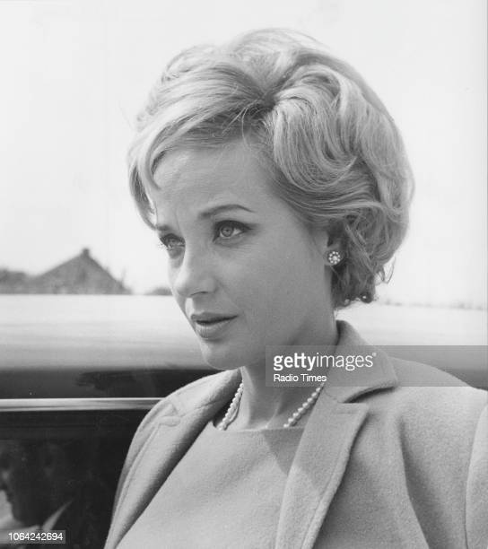 Actress Sylvia Syms pictured leaning from the window of a car in a scene from episode 1 series 1 of the television series 'Bat Out of Hell' 1966