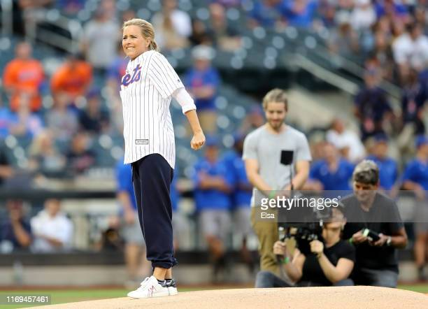 Actress Téa Leoni reacts to a ceremonial first pitch during the filming of Madame Secretary before the game between the New York Mets and the...