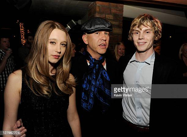 """Actress Taissa Farmiga, producer/creator Ryan Murphy and actor Evan Peters pose at the after party for FX Network's """"American Horror Story"""" at the..."""