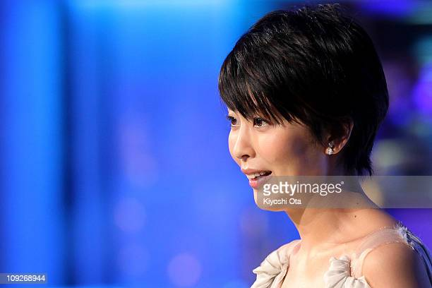 Actress Takako Matsu presents the award for Best Actor In A Leading Role on stage during the 34th Japan Academy Awards at Grand Prince Hotel New...