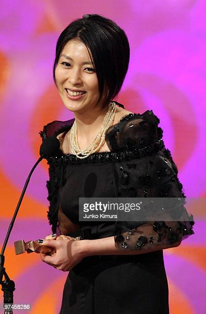 Actress Takako Matsu speaks upon receiving the award for the best actress in a leading role for the film 'Viyon no Tsuma ' during the 33rd Japan...