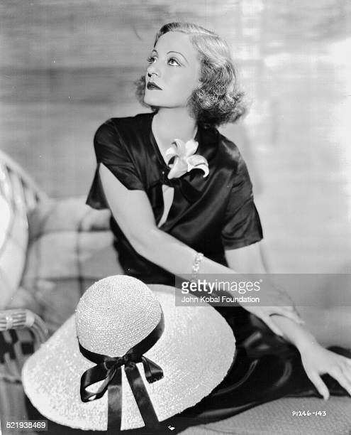 Actress Tallulah Bankhead in a promotional shot for Paramount Pictures wearing a black satin dress 1932