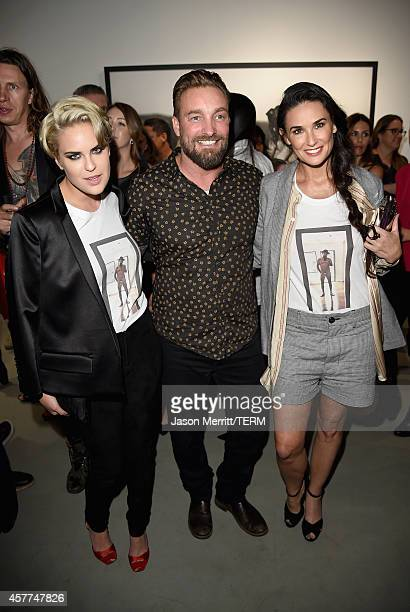Actress Tallulah Willis photographer Brian Bowen Smith and actress Demi Moore attend the Brian Bowen Smith WILDLIFE show hosted by Casamigos Tequila...