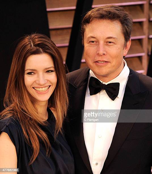 Actress Talulah Riley and CEO of Tesla Motors Elon Musk arrive to the 2014 Vanity Fair Oscar Party on March 2 2014 in West Hollywood California