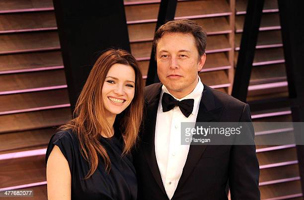 Actress Talulah Riley and CEO of Tesla Motors Elon Musk arrive to the 2014 Vanity Fair Oscar Party on March 2, 2014 in West Hollywood, California.