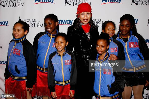 Actress Tamara Tunie poses for a photo with kids of Figure Skating in Harlem at the 2009 Skating with the Stars at Wollman Rink in Central Park on...