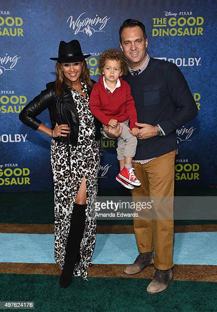 Actress Tamera Mowry her husband Adam Housley and their son Aden Housley arrive at the premiere of DisneyPixar's 'The Good Dinosaur' on November 17...