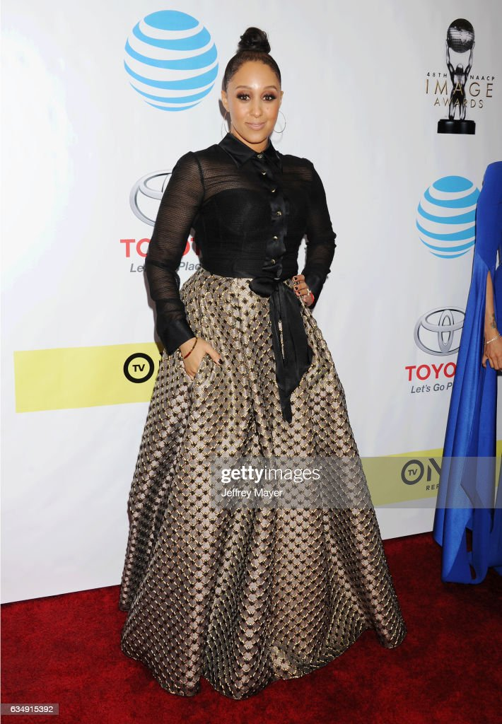 Actress Tamera Mowry-Housely arrives at the 48th NAACP Image Awards at Pasadena Civic Auditorium on February 11, 2017 in Pasadena, California.
