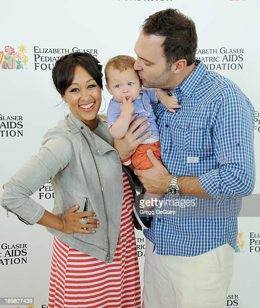 Actress Tamera MowryHousley son Aden Housley and husband Adam Housley arrive at the Elizabeth Glaser Pediatric AIDS Foundation's 24th Annual 'A Time...