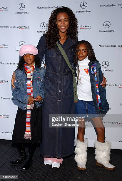 Actress Tami Anderson with daughters Kenni and Lyric attends the MercedesBenz Fashion Week at Smashbox Studios October 29 2004 in Culver City...