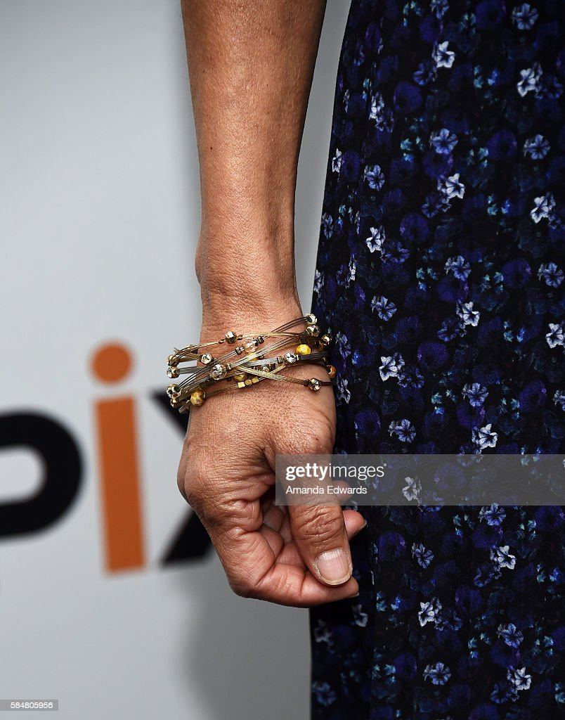Actress Tamlyn Tomita, bracelet detail, attends EPIX's Television Critics Association Tour at The Beverly Hilton Hotel on July 30, 2016 in Beverly Hills, California.