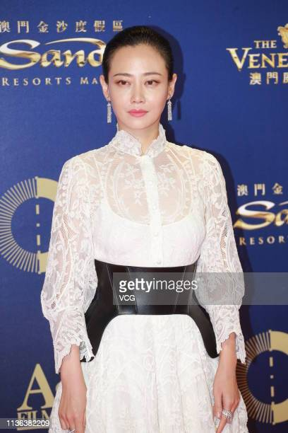Actress Tan Zhuo poses on the red carpet of the 13th Asian Film Awards on March 17 2019 in Hong Kong China