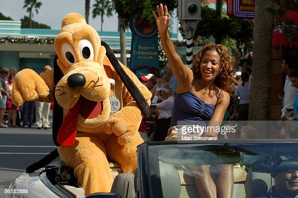 Actress Tanisha Lynn of 'All My Children' waves with Pluto in the celebrity motorcade during ABC's Super Soap Weekend at Walt Disney World's MGM...