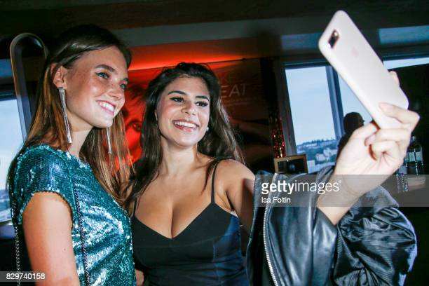 TV actress Tanja Tischewitsch and Germany next topmodel winner Celine Bethmann during the Urban Decay Naked Heat Launch at House of Weekend on August...