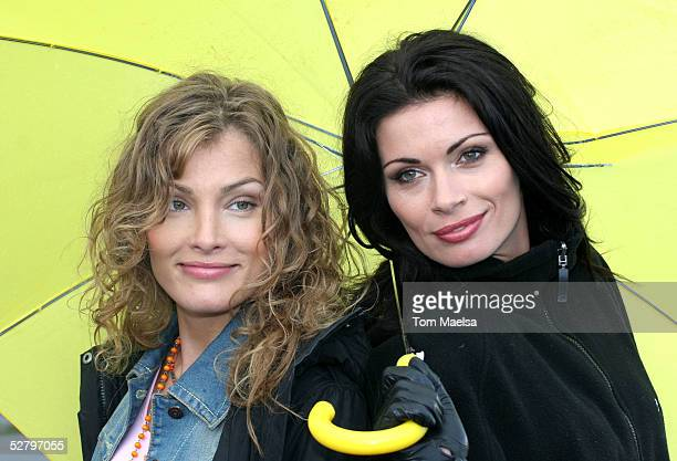 Actress Tanja Wenzel Alison King pose for photographers at a photocall for the TVMovie 'Dark Ride' at Schlossplatz on May 11 2005 in Berlin Germany