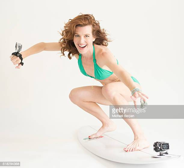 Actress Tanna Fredrick poses with AEE S71T Plus 4K Action Cam in Deep Underwater Housing on an AEE M12 Surfboard Mount and AEE S60 Plus Action Cam in...