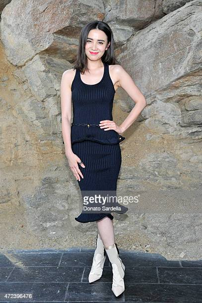 Actress Tao Okamoto attends the Louis Vuitton Cruise 2016 Resort Collection shown at a private residence on May 6, 2015 in Palm Springs, California.