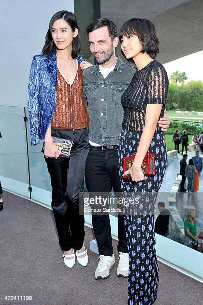Actress Tao Okamoto designer Nicolas Ghesquiere and actress Denise Ho backstage at the Louis Vuitton Cruise 2016 Resort Collection shown at a private...