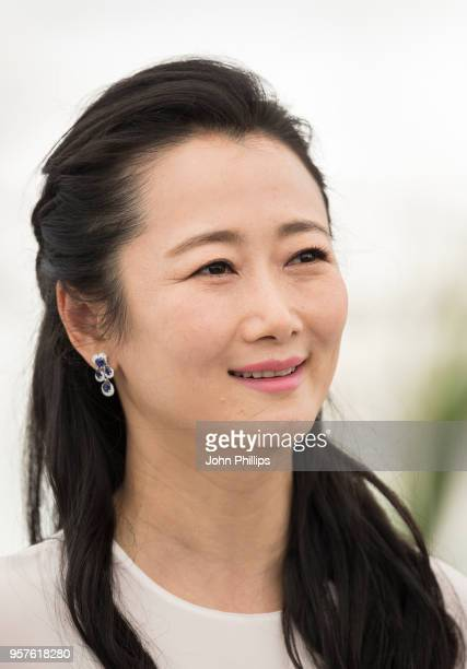 Actress Tao Zha holds her arms up as she attends the photocall for 'Ash Is The Purest White ' during the 71st annual Cannes Film Festival at Palais...