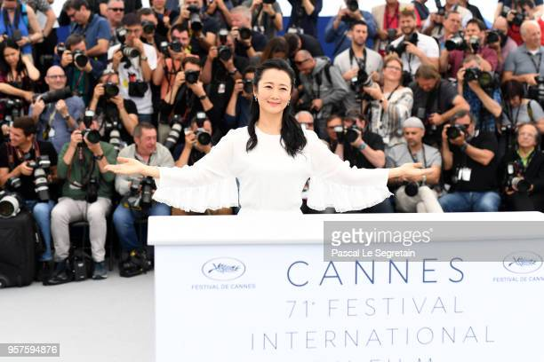 Actress Tao Zha raises her hands as she attends the photocall for 'Ash Is The Purest White ' during the 71st annual Cannes Film Festival at Palais...