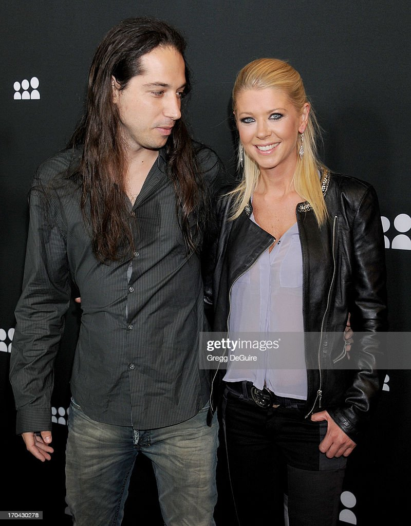 Actress Tara Reid (R) and guest arrive at the Myspace event at El Rey Theatre on June 12, 2013 in Los Angeles, California.
