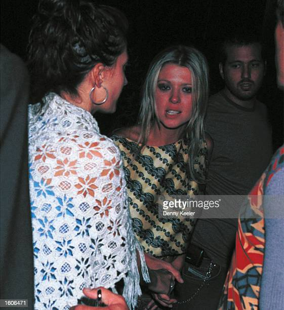 Actress Tara Reid mingles outside The Standard Hotel club August 1 2001 in Hollywood CA