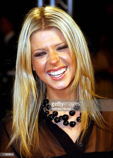 Actress Tara Reid poses for photographers September 1 2001 at the Deauville Film Festival for American Cinema in Deauville France