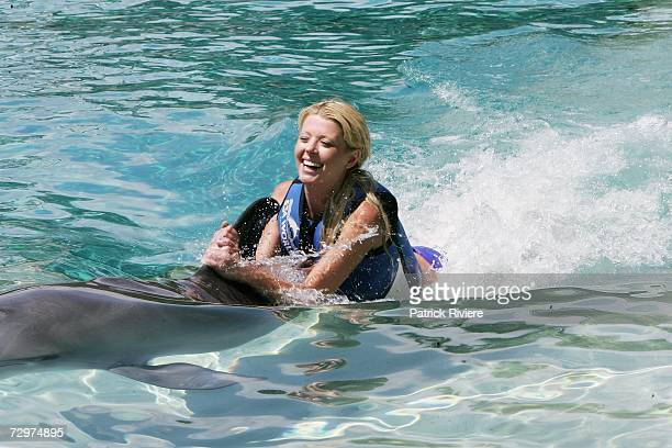 Actress Tara Reid swims with dolphins at Sea World during her stay on The Gold Coast and ahead of her appearance at the Magic Millions horse-racing...