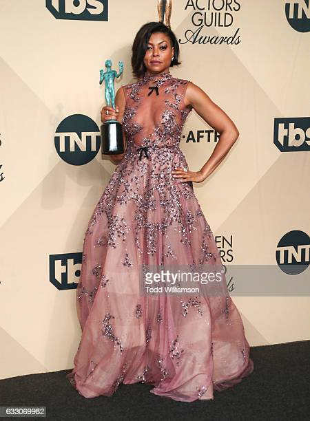 Actress Taraji P Henson recipient of the Outstanding Performance by a Cast in a Motion Picture award for 'Hidden Figures' pose in the press room...