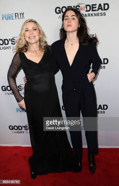 Actress Tatum O'Neal and daughter Emily McEnroe attend the God's Not Dead A Light in Darkness premiere at American Cinematheque's Egyptian Theatre on...