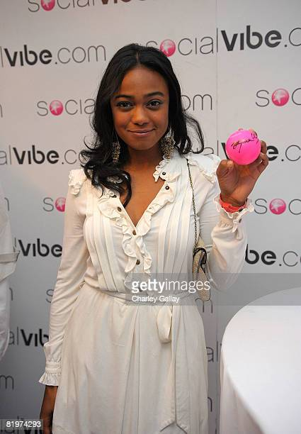 Actress Tatyana Ali signs the Socialvibecom 'Pink Ball' at the launch of the Socialvibecom and HollyRod 4 Kids 'FROM ONE TO A MILLION' campaign at...