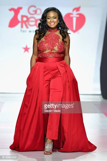 Actress Tatyana Ali walks the runway at the American Heart Association's Go Red For Women Red Dress Collection 2018 presented by Macy's at...