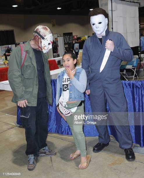 Actress Tava' e Scanlan poses with Jason Voorhees and Michael Myers at the 2019 Long Beach Comic Expo held at Long Beach Convention Center on...