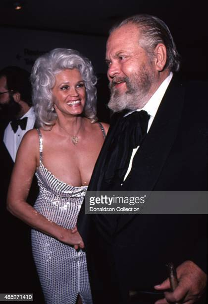 Actress Tawni Sims and director Orson Welles attends an awards dinner given by the National Alliance of Theatre Owners at the Bonaventure Hotel in...
