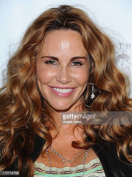Actress Tawny Kitaen arrives at the opening night of 'Rain A Tribute To The Beatles' at the Pantages Theatre on April 12 2011 in Hollywood California