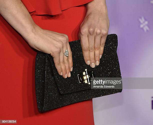 Actress Taylor Cole clutch detail arrives at the Hallmark Channel and Hallmark Movies and Mysteries Winter 2016 TCA Press Tour at Tournament House on...