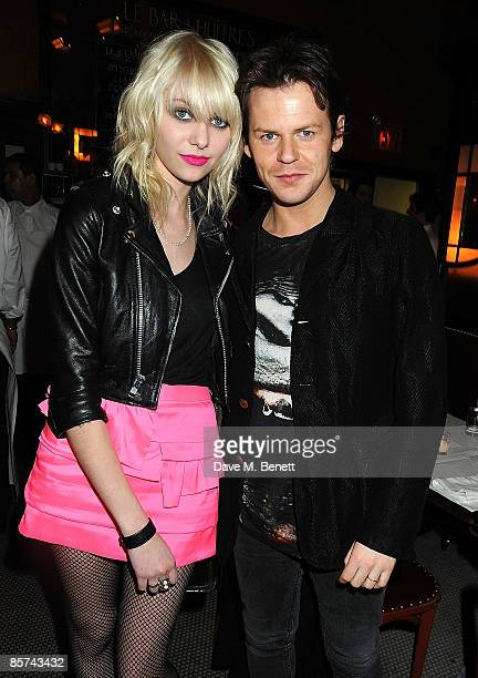 Actress Taylor Momsen and designer Christopher Kane attend the Topshop New York VIP Dinner at Balthazar on March 31, 2009 in New York City.